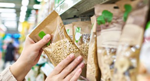Buyer,Hands,With,The,Packaging,Of,Pine,Nuts,In,The