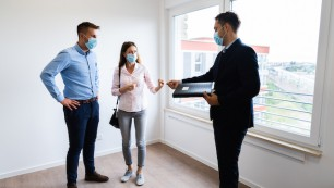 Happy,Couple,Buying,New,Home,With,Realtor,Wearing,Face,Masks